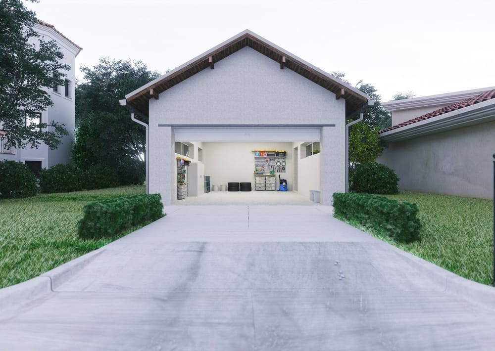 a beautiful garage with concrete driveway at essendon concreters