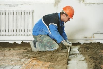 Man laying Essendon Concreters concrete on home flooring